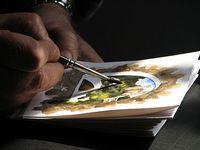Dolceacqua43_-_Artista_locale_mentre_dipinge_un_acquarello wiki