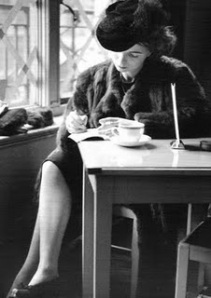 Woman-writing-in-cafe_2